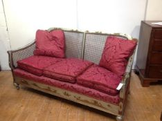 A 1920's silver lacquer Chinoiserie bergere sofa, probably Hille of London, the twin panel