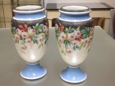 A pair of large Victorian painted opaque glass vases, of baluster form, each with white metal rim,