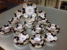 A 19th century Coalport tea service, comprising eight teacups, twelve saucers, nine side plates,