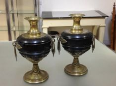 An imposing pair of late 19th century bronze-mounted slate vases, each with elongated everted neck