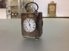 An Edwardian silver travelling carriage clock of small proportions, the case hallmarked for London