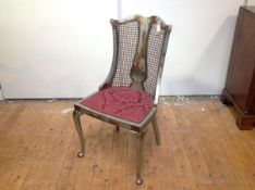 A 1920's silver lacquer Chinoiserie drawing room chair, probably Hille of London, the curved back