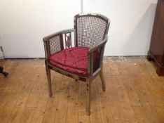 A 1920's silver lacquer Chinoiserie canework open armchair, probably Hille of London, the shaped