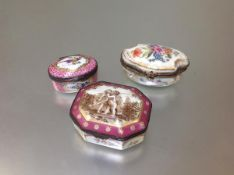 A group of three Continental porcelain table boxes, 19th century and later, the first of shaped oval