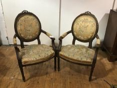 A pair of Louis XVI style fauteuils, late 19th century, the beechwood frames with remnants of