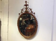 An Edwardian Adam Revival oval gilt wall mirror, the oval plate within a conforming frame, with