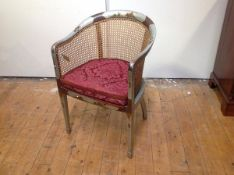 A 1920's silver lacquer Chinoiserie tub chair, probably Hille of London, with canework back and