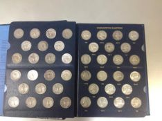 A group of US Washington Quarters in a Whitman album, 1932-64, c. 83 coins complete with mint marks,