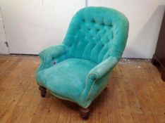 A Victorian lady's buttoned spoon back drawing room chair, upholstered in turquoise velvet, raised