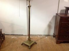 A brass Corinthian columnar standard lamp, the fluted column raised on a stepped square base