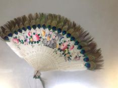 A Qing dynasty painted feather and peacock feather fan, late 19th century, the white feathers