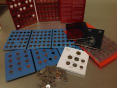 A group of Canadian coins: mostly base metal 1 cent and 5 cent, mostly in Whitmans folders and a