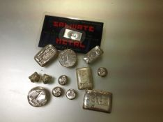 A group of poured silver ingots, stamped 999. 285 grams