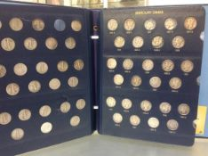 A group of c. 75 U.S. Mercury dimes in a Whitman album, condition G to EF, various dates or mint