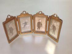 A French gilt-metal quadtych folding photograph frame, each rectangular aperture beneath a floral