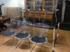 A set of six metal wirework side chairs after a design by Harry Bertoia, of bent and welded rod
