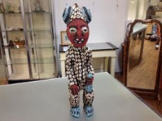 A large Cameroon Bamum standing figure, the body decorated throughout with blue and red beads and