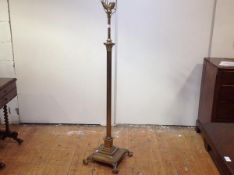 An early 20th century brass Corinthian column adjustable standard lamp, the fluted column raised