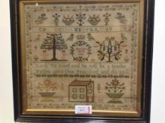 An early 19th century needlework sampler, Harriott Brett 1815, worked in colours with a house,