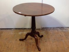 A George III mahogany tripod table, the circular top raised on a handsome fluted columnar standard