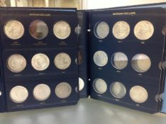 Two Whitman albums containing a group of c. 38 Morgan dollars 1878-1921, 900 standard, no