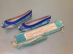 A pair of Chinese lady's embroidered silk shoes, c. 1920's, each worked with birds and flowering