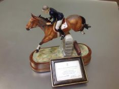 A Royal Worcester limited edition porcelain model, Stroller and Marion Coakes, mounted on a wooden