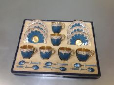 A Royal Worcester coffee service for six cased with six enamelled silver coffee spoons, the cups and