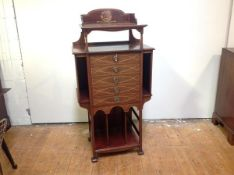 An Edwardian inlaid mahogany music cabinet, in the Art Nouveau taste, the rectangular top with