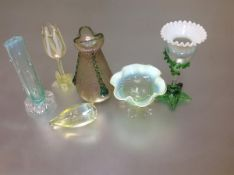 A group of late 19th century vaseline and coloured decorative glass comprising: a vaseline tulip-