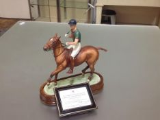 A Royal Worcester limited edition porcelain model of H.R.H. The Duke of Edinburgh, mounted on a polo