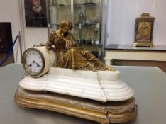 A French 19th century gilt-metal and alabaster mantel clock, the drum head white enamel dial applied