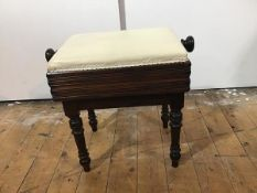 An early Victorian rosewood adjustable piano stool, the rectangular stuffed-over seat over a box