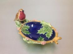 A Minton majolica nut dish, c. 1870, oval, moulded with holly leaves, a robin perched on the rim,