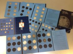 Seven Whitman albums of Canadian silver coins, mostly 800 standard, different dates and types,
