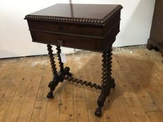 A William IV well-figured mahogany work table, the rectangular hinged top with boldly carved
