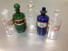 A group of five late 19th/early 20th century coloured and clear glass pharmacy jars comprising: a