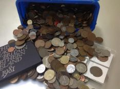 A box containing a quantity of UK and World coins, mostly lower value, several hundred