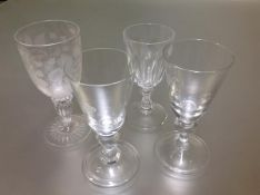 A group of 19th century and later baluster stem drinking glasses comprising: a rummer with bucket