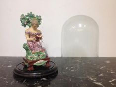 """An unusual large Staffordshire pearlware table base bocage figure, """"The Villeg Made"""", modelled as"""