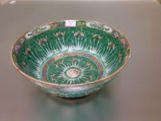 A Chinese porcelain punch bowl, polychrome painted to the exterior and the well with butterflies