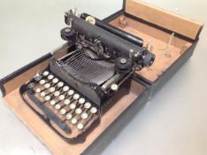 A travelling cased folding Corona typewriter no. 3. Case 12cm by 28cm by 24.5cm