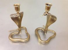 A pair of large Indian cast brass cobra candlesticks. 29cm