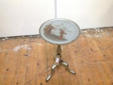 A 1920's silver lacquer Chinoiserie small tripod table, probably Hille of London, the dished