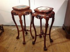 A pair of Chinese marble-inset hardwood vase or plant stands, each with shaped square top over a