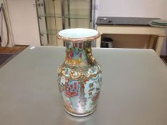 A Canton Export famille rose vase, c. 1900, of baluster form, with everted scalloped rim, moulded