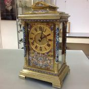 A rare and imposing champleve enamel and brass musical-chiming four glass bracket clock, late 19th