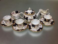 A 19th century Coalport blue Batwing partial tea service, pattern no. Y2665, comprising teapot,