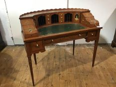 An Edwardian lady's painted satinwood Carlton House desk, the curved superstructure with scroll-