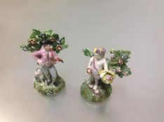 Two Walton style Staffordshire pearlware bocage figures, 19th century, one modelled as a huntsman, a